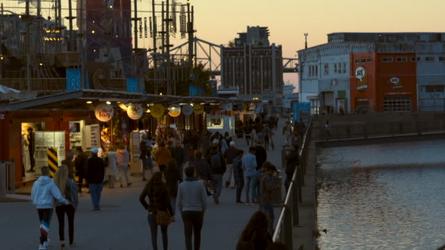 slow motion: view of waterfront market with people walking & browsing - montréal stock videos & royalty-free footage