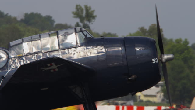 slow motion vintage us military bomber taxis down runway at an air show. - bomber plane stock videos and b-roll footage