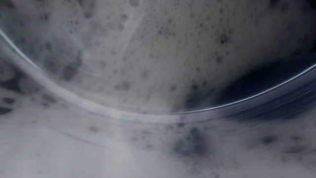slow motion washing machine washes clothes - close-up - dryer stock videos & royalty-free footage
