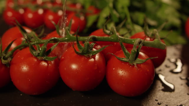 4k slow motion - washing tomatoes - wet stock videos & royalty-free footage