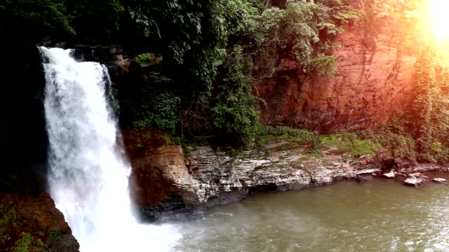 slow motion waterfall during sunset time, goa - goa stock videos & royalty-free footage