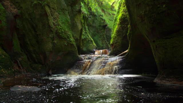 slow motion. waterfall in the famous finnich glen near killearn. - stirling stock videos & royalty-free footage