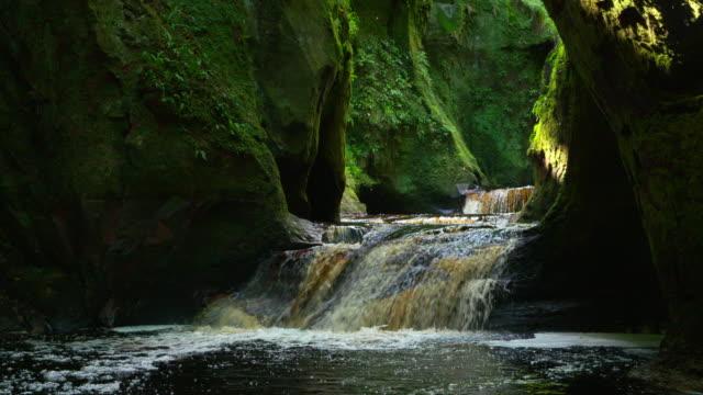 slow motion. waterfall in the famous finnich glen near killearn. - ravine stock videos & royalty-free footage
