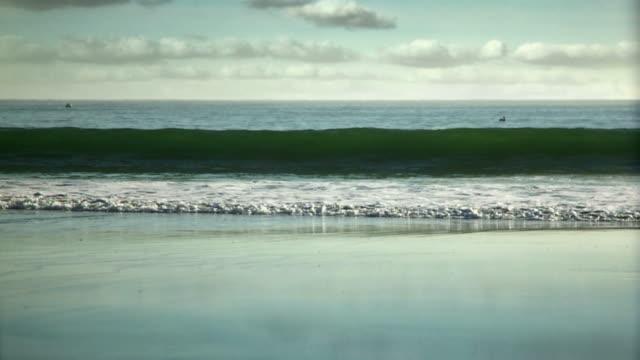 Slow motion waves crashing on the beach