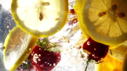 Slow Motion Whirlpool with Sliced Lemon and Strawberry