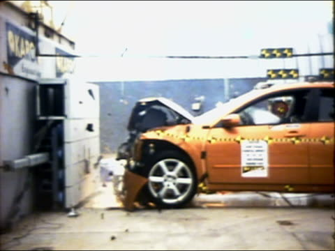 slow motion wide shot 35mph frontal barrier impact test on 2004 four-door nissan maxima with crash test dummies - crash test stock videos & royalty-free footage