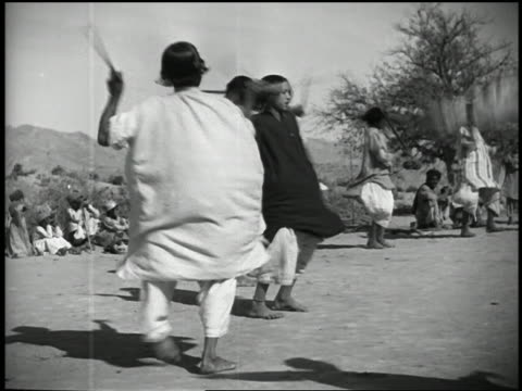 1932 slow motion wide shot group of waziri tribesmen performing sword dance - martial arts stock videos & royalty-free footage