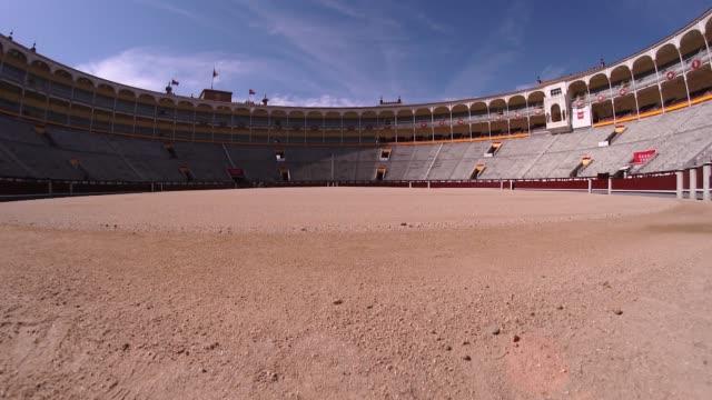 slow motion wide shot view across madrid's famous bullring arena, plaza de toros de las ventas - bullfighter stock videos & royalty-free footage