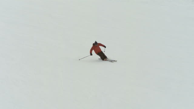 """slow motion wide skier """"carving"""" down piste, france (individual frames may also be used as a still image. each frame in its raw state is about 6mb or about 12mb as a 16 bit tiff) - steep hill stock videos & royalty-free footage"""