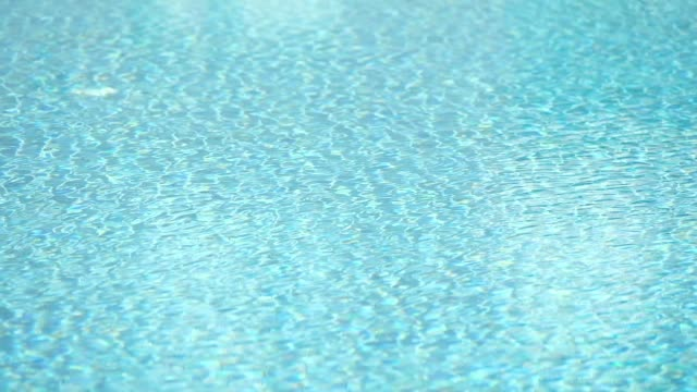 slow motion wind blow surface water of swimming pool wave - pool stock videos & royalty-free footage