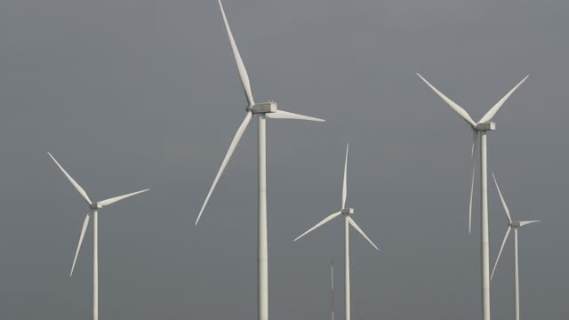 Slow Motion wind turbines stand at the Subplu wind farm operated by Gunkul Engineering Pcl in Huay Bong Thailand on Thursday Nov 2 2017