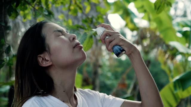 Slow Motion : Woman Applying Fragrance