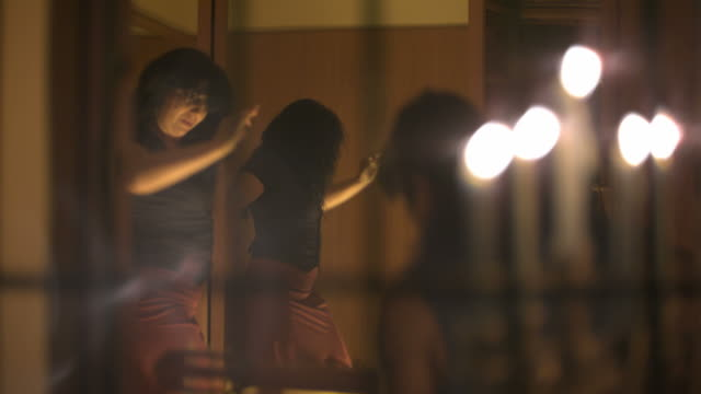 slow motion woman dancing to music in candlelit room through window, spain (individual frames may also be used as a still image. each frame in its raw state is about 6mb or about 12mb as a 16 bit tiff) - slow dancing stock videos and b-roll footage
