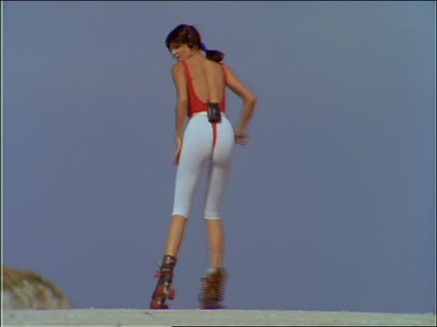 slow motion woman dancing to music on roller skates - stereo personale video stock e b–roll