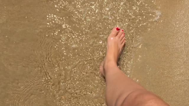 slow motion pov of woman feet walking on a beach - sand stock videos & royalty-free footage