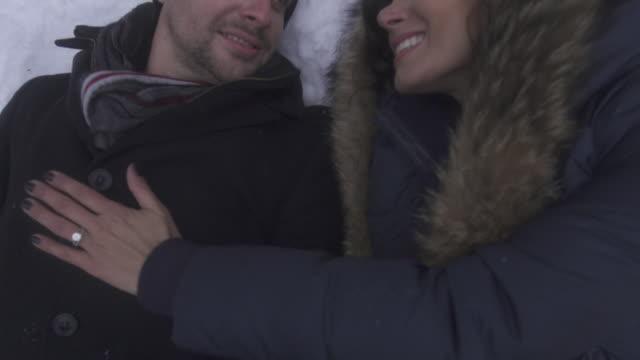 vídeos de stock e filmes b-roll de slow motion (boom up) woman puts hand on mans chest as they kiss 3 - 50 segundos ou mais