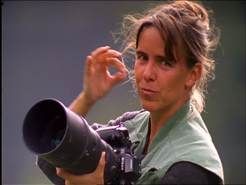 slow motion woman with long lens camera giving thumbs-up sign - 1997 stock videos & royalty-free footage