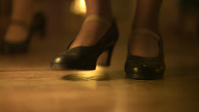 slow motion woman's dancing feet and shoes, spain (individual frames may also be used as a still image. each frame in its raw state is about 6mb or about 12mb as a 16 bit tiff) - wood material stock videos & royalty-free footage