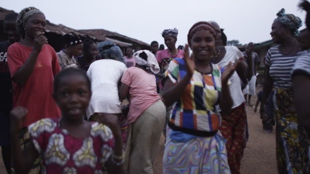 slow motion women dancing and chanting - sierra leone stock videos & royalty-free footage