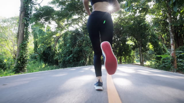 slo mo slow motion women exercise running jogging in the public park - sportswear stock videos & royalty-free footage