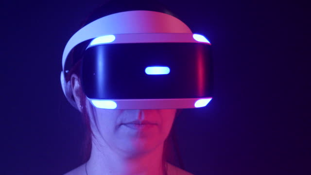Slow motion, women uses virtual reality headset