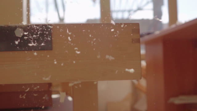 Slow motion: wooden scraps falling down