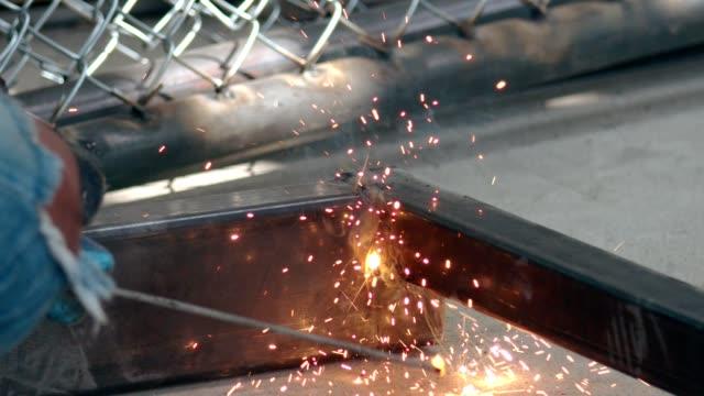 slow motion : worker grinding a sheet of metal - steel stock videos & royalty-free footage
