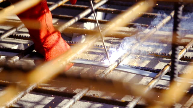 slow motion: worker welding steel and audio - welding stock videos & royalty-free footage