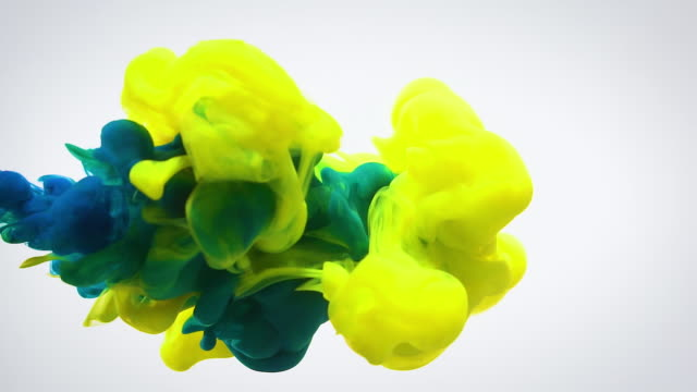 slow motion yellow and blue ink flow in water. - mixing stock videos & royalty-free footage