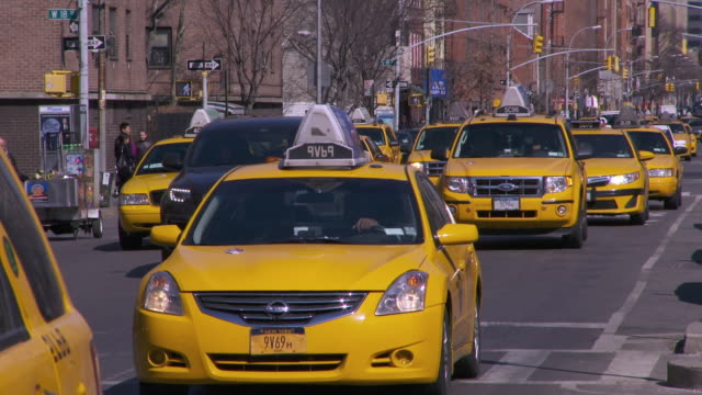 slow motion yellow taxis in downtown manhattan - other stock videos and b-roll footage