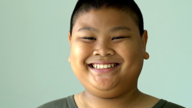 Slow motion young asian boy smiling