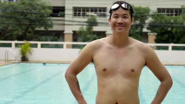 slow motion young asian man swimmer portrait athlete. - swimming goggles stock videos & royalty-free footage