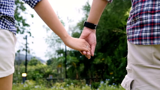 Slow Motion : Young Couple Walking In park