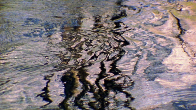 slow motion zoom in close up reflections in ripples on water / merced river, yosemite national park, california - river merced stock videos & royalty-free footage