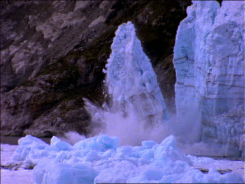 slow motion zoom in of ice falling into water from Sawyer Glacier / Alaska