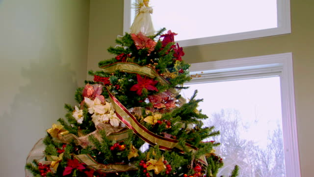 slow motion, zoom in on christmas tree topper, an angel - ribbon sewing item stock videos & royalty-free footage