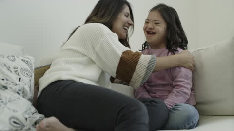 slow motion zoom in to smiling mother hugging daughter with down syndrome / lehi, utah, united states - brown hair stock videos & royalty-free footage