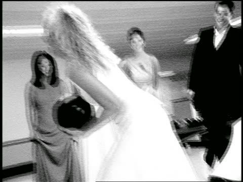vídeos y material grabado en eventos de stock de b/w slow motion zoom in + zoom out blonde bride preparing to bowl as bridesmaids + ushers watch in bowling alley - bola de bolos