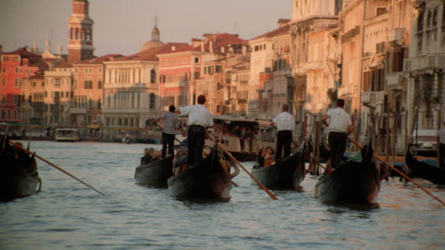 slow motion zoom out of gondolas on grand canal / venice - grand canal venice stock videos & royalty-free footage