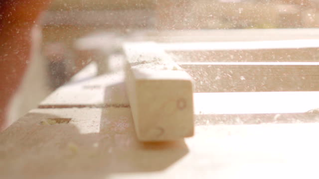 slow motion:blowing dust from a plank - hand saw stock videos and b-roll footage