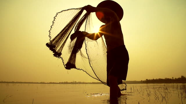 hd slow motion:local lifestyles of fisherman working in the morning sunrise. - myanmar stock videos and b-roll footage