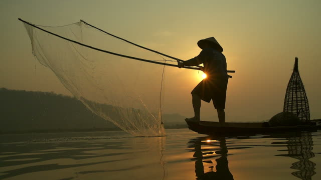 hd slow motion:local lifestyles of fisherman working in the morning sunrise. - developing countries stock videos & royalty-free footage