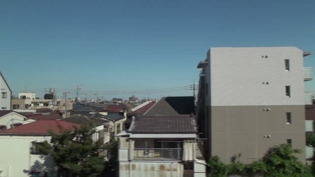 slow motion,side pov,view from through the window.tokyo,japan. - 集合住宅点の映像素材/bロール