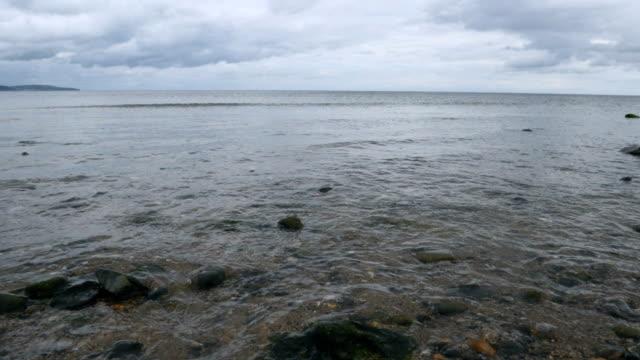 slow motion:wave smashing the beach,Northern Ireland