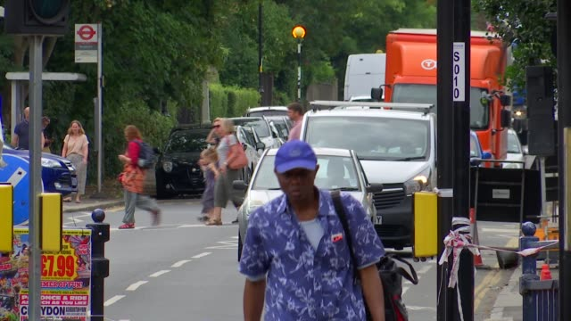 slow moving traffic in crystal palace; england: london: croydon: crystal palace: church road: ext traffic waiting at temporary traffic lights and... - waiting stock videos & royalty-free footage