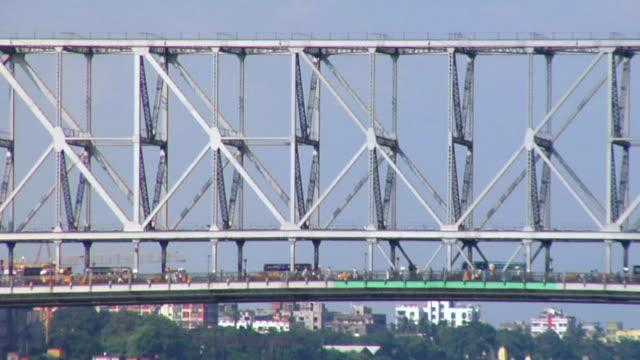 cu slow moving traffic on howrah bridge  / kolkata, west bengal, india - howrah bridge stock videos & royalty-free footage