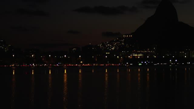slow night pan of rio shoreline - 2013 stock videos & royalty-free footage