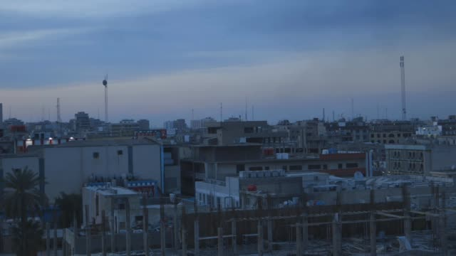 slow pan across baghdad at dusk, wide shot - baghdad stock videos & royalty-free footage