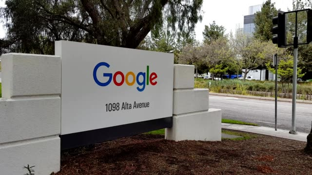 slow pan from signage for google inc across to the facade of the googleplex the silicon valley headquarters of the search engine and technology... - 本部点の映像素材/bロール