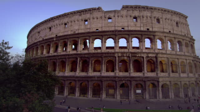 slow pan of colosseum and constantine's arch - arch of constantine stock videos and b-roll footage